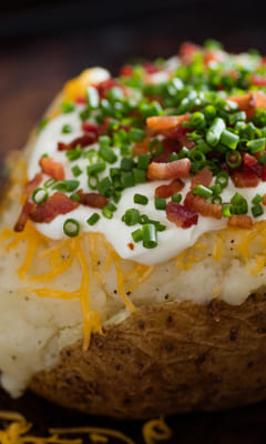 Baked potato with brynza and cheese with spices