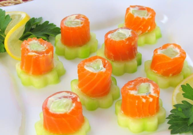 Rolls of trout with cucumber and salted cheese mass