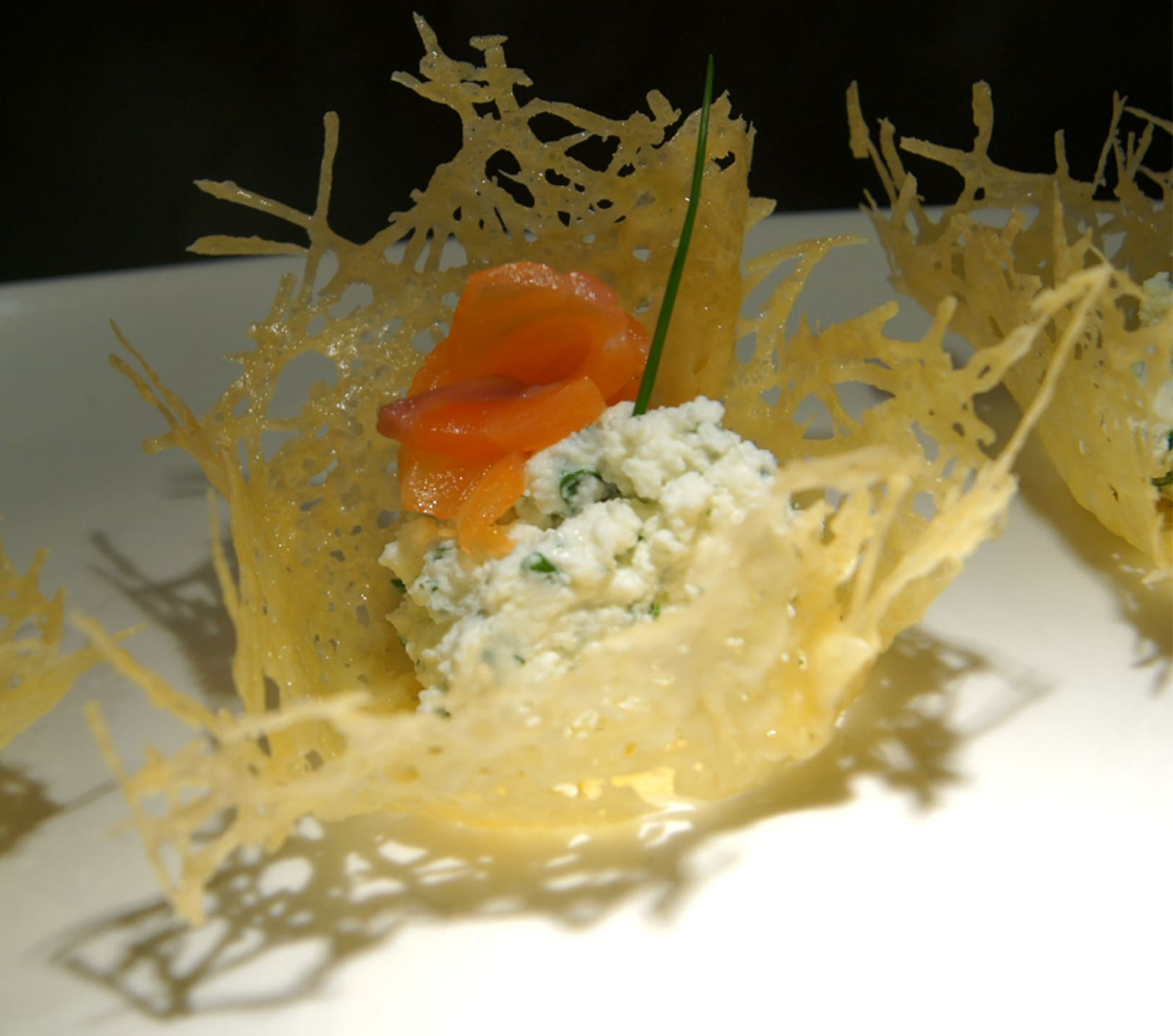 Appetizer with salmon and ricotta in cheese buscets